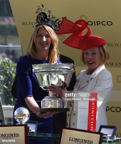 Former tennis player Steffi Graf hands over the winners trophy to Serbina Power owner of the horse Sole Power the winner of the King's Stand Stakes