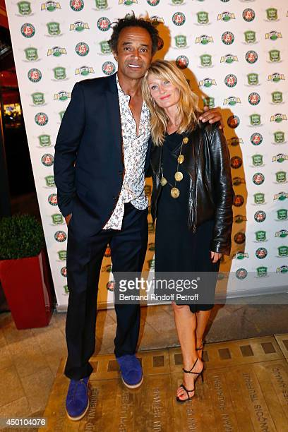 Former tennis player Yannick Noah and his wife producer Isabelle Camus attend the Legends of Tennis Dinner Held at Restaurant Fouquet's whyle Roland...