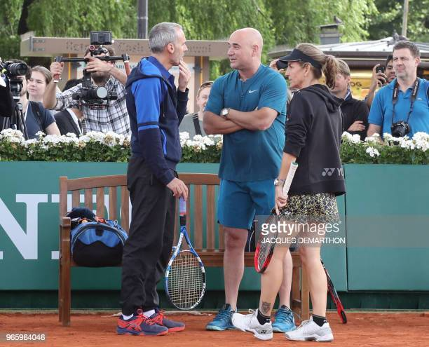 Former tennis players Andre Agassi Alex Corretja and Arantxa Sanchez take part in a tennis event in Paris on June 2 as part of the Longines Future...