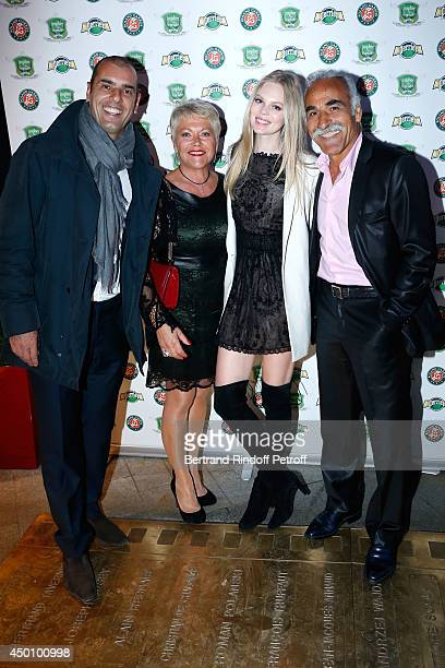 Former tennis players Cedric Pioline with wife , Mansour Bahrami with his wife Frederique attend the Legends of Tennis Dinner. Held at Restaurant...