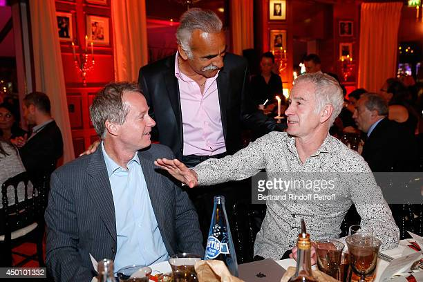 Former tennis players Mansour Bahrami John McEnroe and his brother Patrick McEnroe attend the Legends of Tennis Dinner Held at Restaurant Fouquet's...