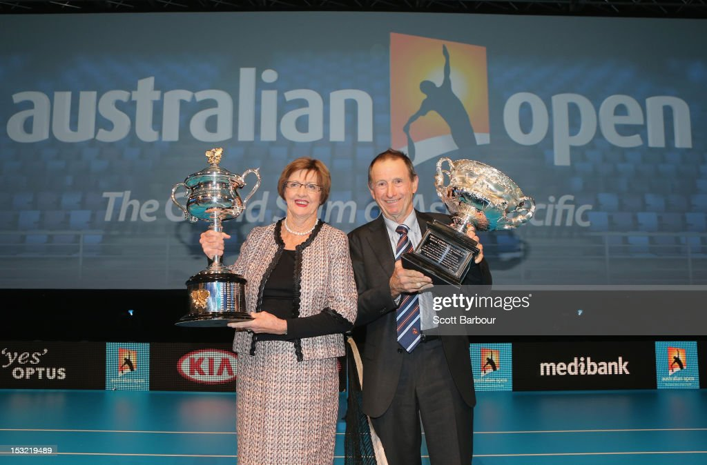 Former tennis players Margaret Court and Ashley Cooper pose with the Norman Brookes Challenge Cup and the Daphne Akhurst Trophy during the 2013 Australian Open launch at Melbourne Park on October 2, 2012 in Melbourne, Australia.