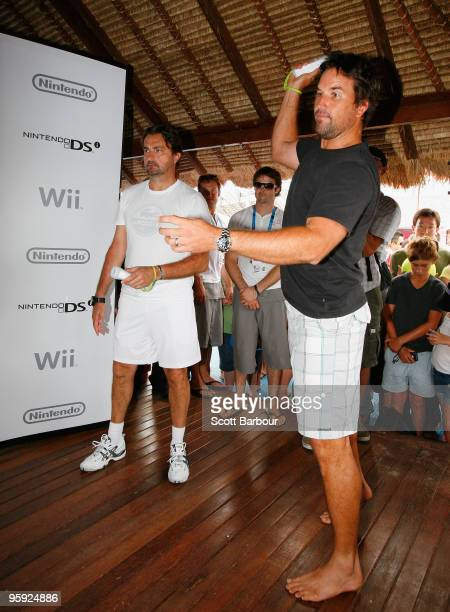 Former tennis players Pat Rafter and Henri Leconte compete in a Wii Sports tennis showdown at Grand Slam Oval during day five of the 2010 Australian...