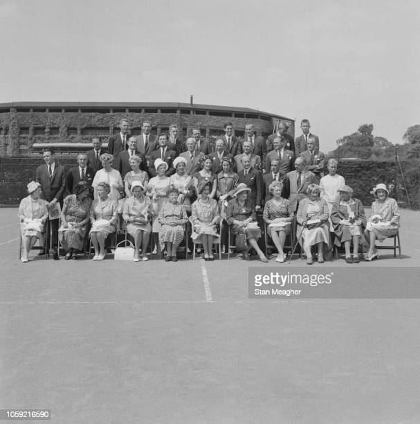 Former tennis players pose for a group photo as they attend the Wimbledon Luncheon for former champions, to celebrate the 75th anniversary of the...
