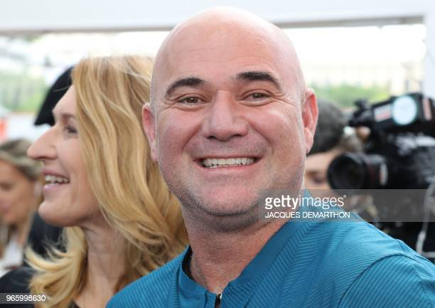Former tennis players Steffi Graf and Andre Agassi arrive to head back on court in Paris during a tennis event in Paris on June 2 as part of the...
