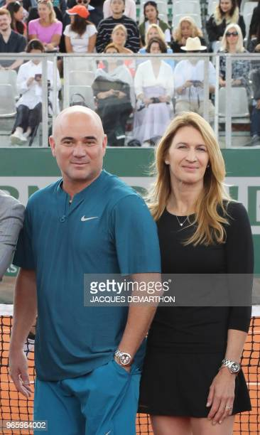 Former tennis players Steffi Graf and Andre Agassi take part in a tennis event in Paris on June 2 as part of the Longines Future Tennis Ace