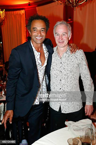 Former tennis players Yannick Noah and John McEnroe attend the Legends of Tennis Dinner Held at Restaurant Fouquet's whyle Roland Garros French...