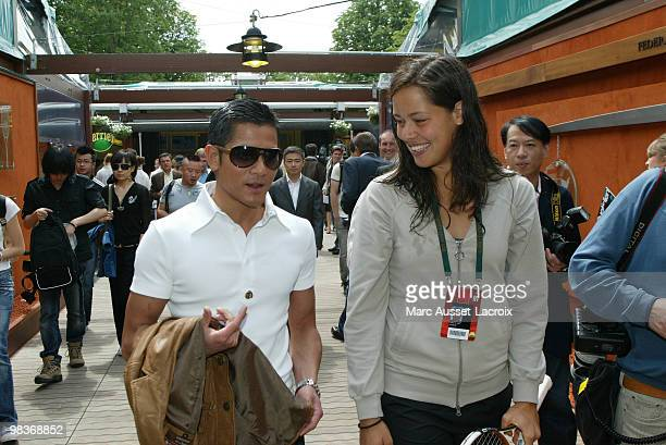 Former tennis pro Ana Ivanovic with Chinese actor Aaron Kwok poses in the 'Village' the VIP area of the French Open at Roland Garros arena in Paris...