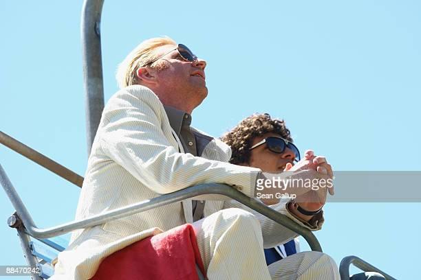 Former tennis star Boris Becker and his eldest son Noah ride a ski lift to the Boris Becker's wedding brunch reception at the El Paradiso mountain...