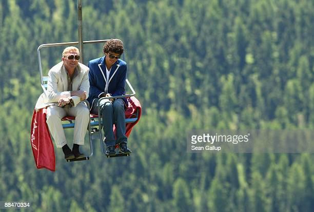 Former tennis star Boris Becker and his eldest son Noah ride a ski lift to Boris Becker's wedding brunch reception at the El Paradiso mountain...