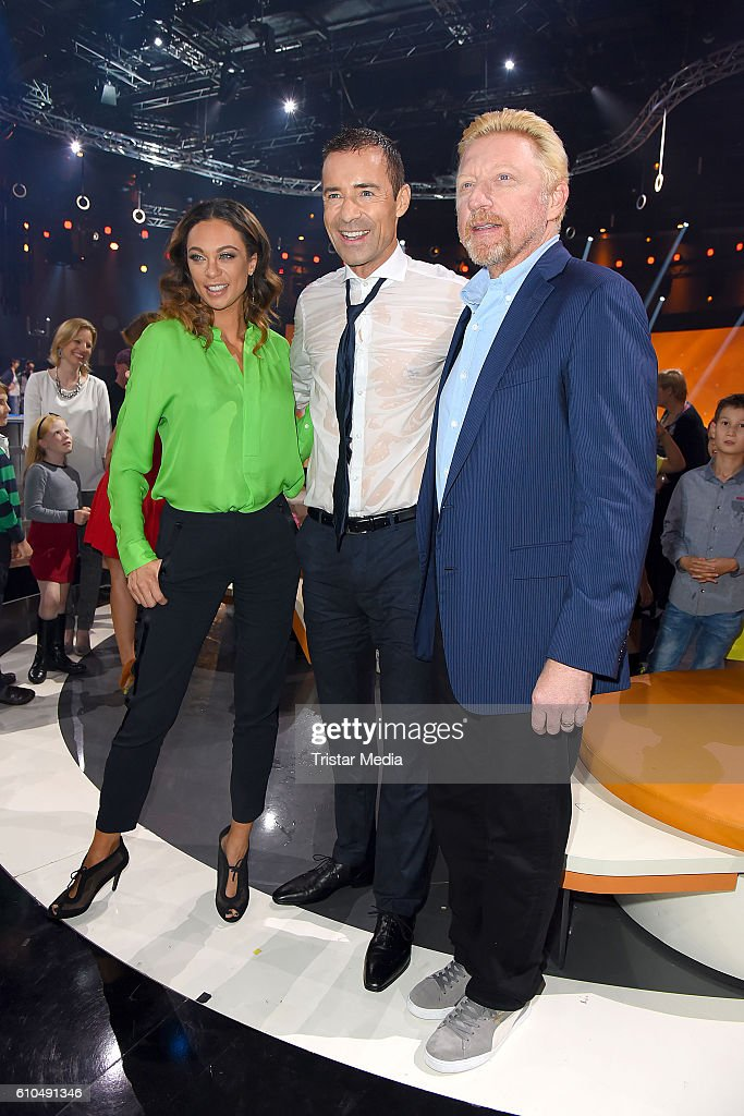 Former Tennis star Boris Becker (R) and his wife Lilly Becker with german moderator Kai Pflaume at the tv show 'Klein gegen Gross - Das unglaubliche Duell' on September 25, 2016 in Berlin, Germany.
