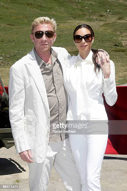 Former tennis star Boris Becker and his wife Sharlely pose for a picture after taking a ski lift to their wedding brunch reception on June 13 2009 in...
