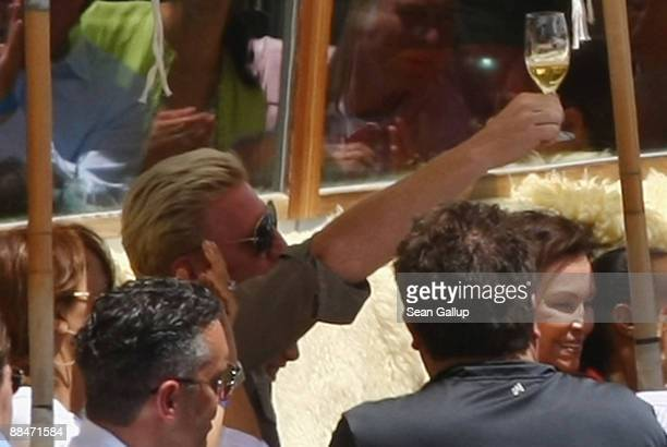 Former tennis star Boris Becker raises a beer glass at wedding brunch reception for him and his bride Sharlely Becker at the El Paradiso mountain...