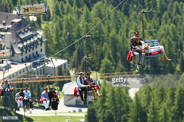 Former tennis star CarlUwe 'Charly' Steeb and his wife Kim Steeb join other guests as they ride a ski lift to the wedding brunch reception of former...