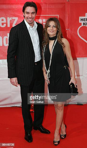 Former tennis star Michael Stich and his wife Alexandra arrive at the Ein Herz Fuer Kinder television charity gala at the Axel Springer Halle...