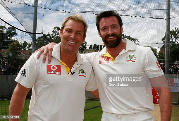 Former test cricketer Shane Warne and actor Hugh Jackman pose after playing cricket in the nets during day one of the Fourth Test match between...