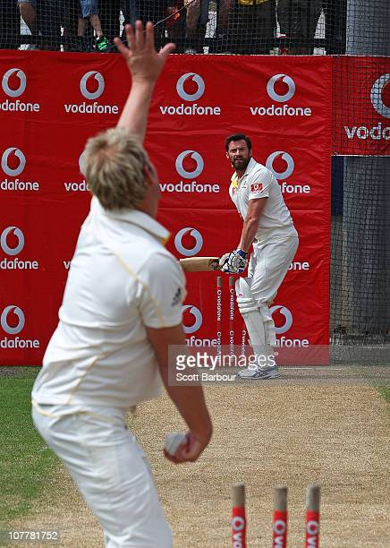 Former test cricketer Shane Warne bowls to actor Hugh Jackman as they play cricket in the nets during day one of the Fourth Test match between...