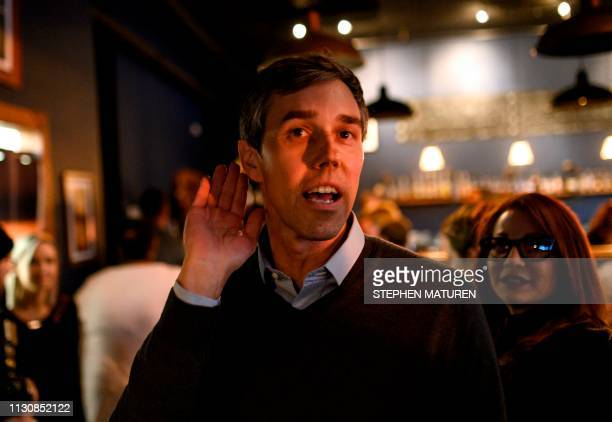 Former Texas Congressman and Democratic party presidential candidate Beto O'Rourke leans in to hear a comment after speaking to diners at The Pig...