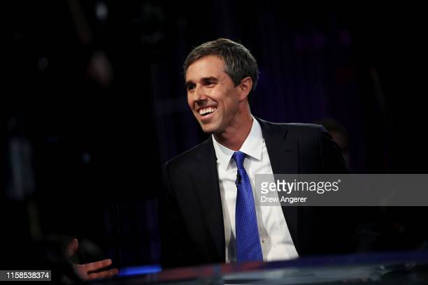 former Texas congressman Beto O'Rourke speaks to the media in the spin room after the first night of the Democratic presidential debate on June 26...