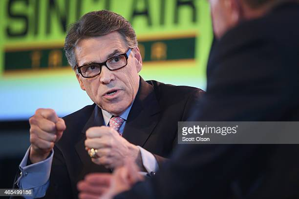 Former Texas Governor Rick Perry fields questions from Bruce Rastetter at the Iowa Ag Summit on March 7 2015 in Des Moines Iowa The event allows the...