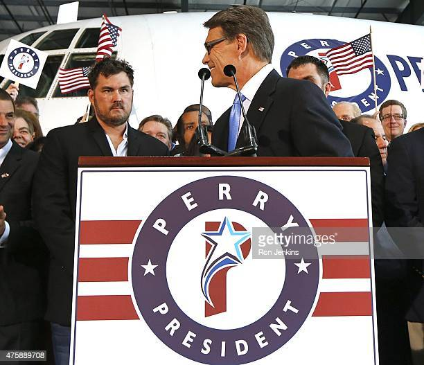 Former Texas Governor Rick Perry takes the stage as supporters including retired US Navy SEAL and author of the book Lone Survivor Marcus Luttrell...