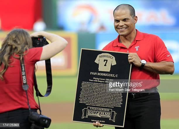Former Texas Rangers catcher Ivan Pudge Rodriguez has his photo taken with his plaque at his inducton into the Texas Rangers Hall of Fame on Saturday...