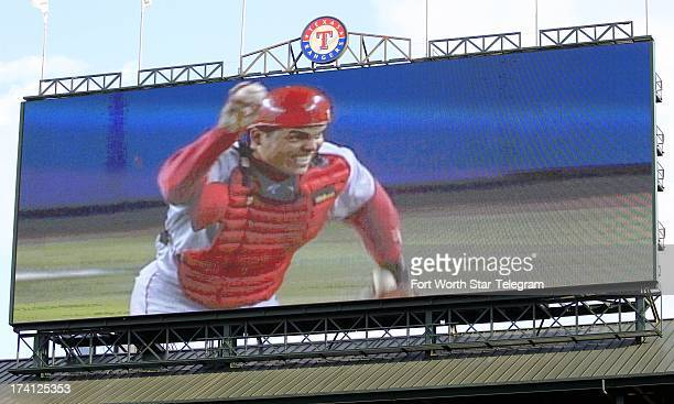 Former Texas Rangers catcher Ivan Pudge Rodriguez waves the ball in the air in an archive video during his induction into the Texas Rangers Hall of...