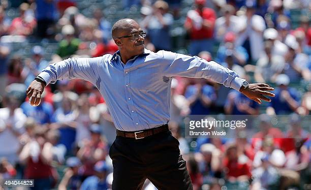 Former Texas Rangers player Julio Franco throws a ceremonial first pitch before the start of a baseball game against the Toronto Blue Jays at Globe...