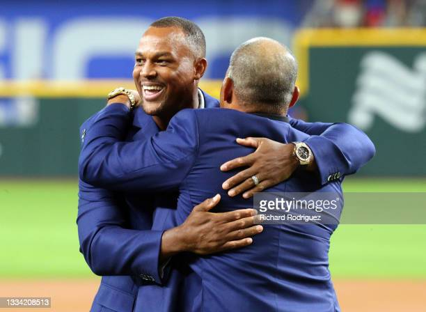 Former Texas Rangers third baseman Adrian Beltre hugs Ivan Rodriguez after being inducted into the Texas Rangers Hall of Fame at Globe Life Field on...