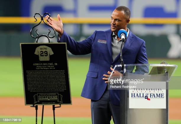 Former Texas Rangers third baseman Adrian Beltre speaks at a ceremony where he was inducted into the Texas Rangers Hall of Fame before the game...