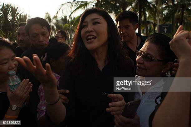 Former Thai prime minister Yingluck Shinawatra thanks her supporters for purchasing rice outside of a shopping mall in Bangkok Thailand on 5 November...