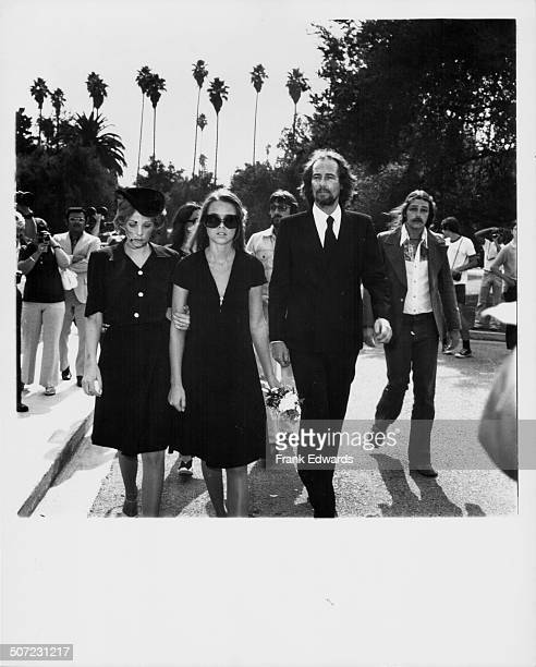 Former 'The Mamas and the Papas' band members Michelle Phillips and John Phillips with his new wife Genevieve Waite attending the funeral of Cass...