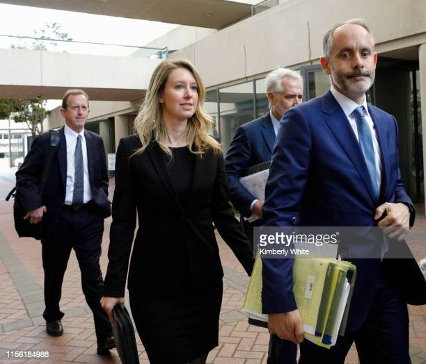 Former Theranos CEO Elizabeth Holmes leaves federal court with her legal team after a status hearing on July 17, 2019 in San Jose, California. Holmes...
