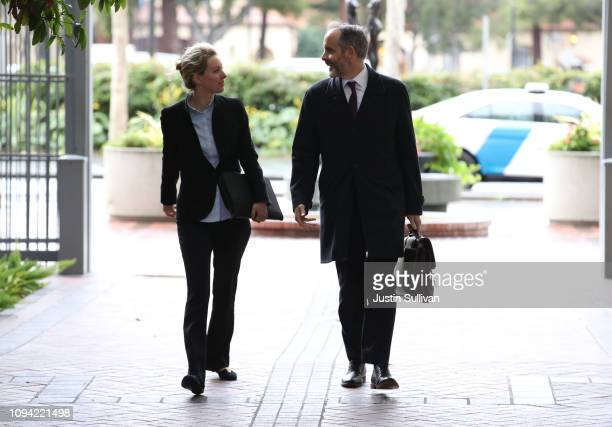 Former Theranos founder and CEO Elizabeth Holmes arrives at the Robert F Peckham US Federal Court with her attorney on January 14 2019 in San Jose...