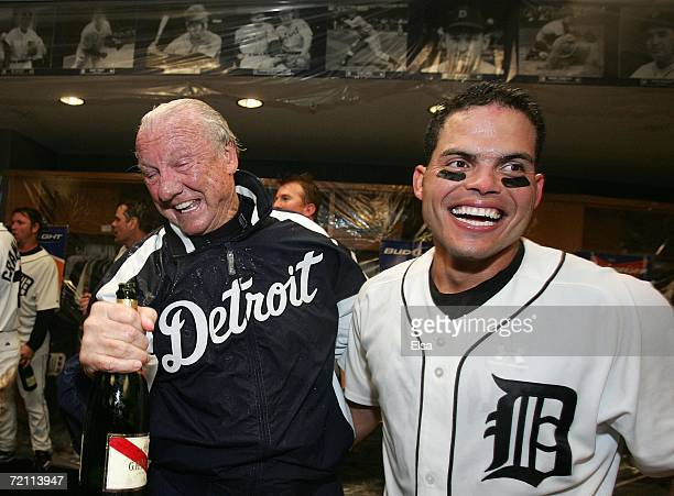 Former Tiger great Al Kaline and catcher Ivan Rodriguez of the Detroit Tigers celebrate in the locker room after the Tigers' 8-3 win against the New...
