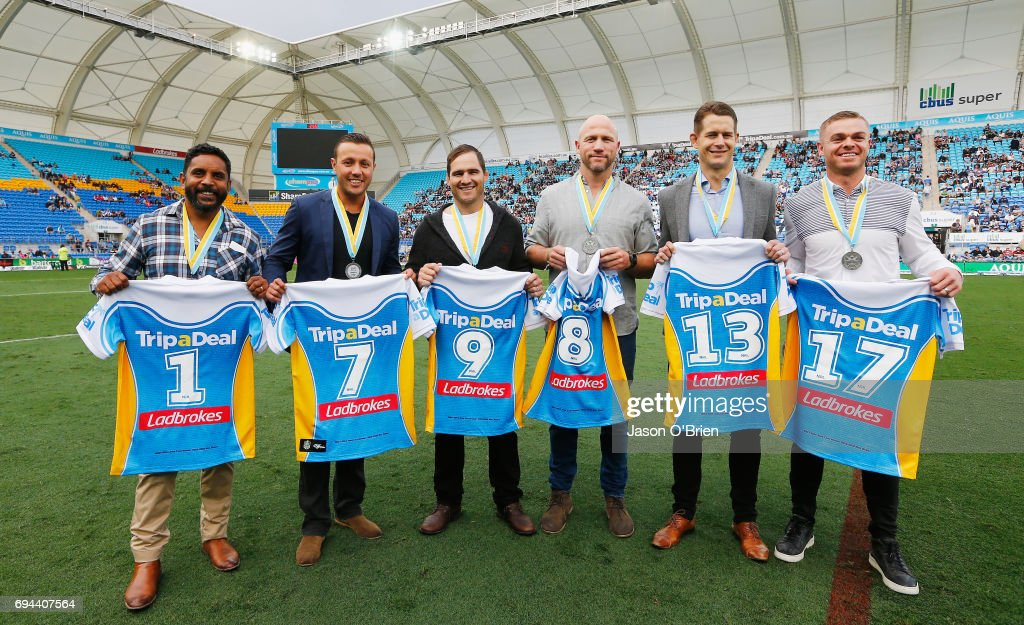 Former titan players who were named in the team of the decade pose for a photograph during the round 14 NRL match between the Gold Coast Titans and the New Zealand Warriors at Cbus Super Stadium on June 10, 2017 in Gold Coast, Australia.