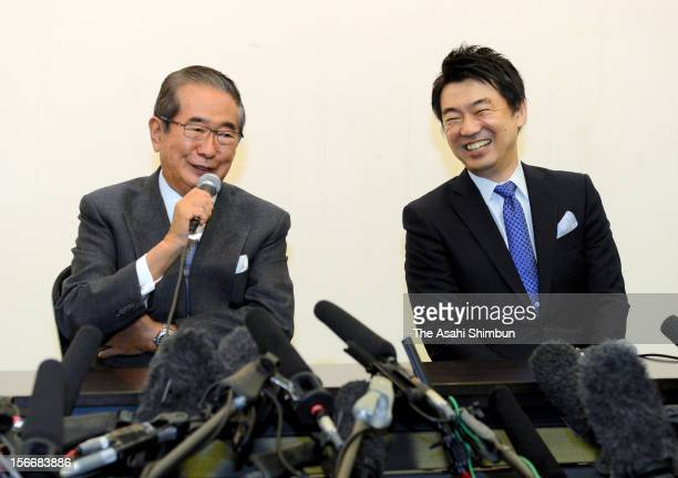 Former Tokyo governor Shintaro Ishihara and Osaka City mayor Toru Hashimoto attend a press conference on the merger of the Sunrise Party and Japan...
