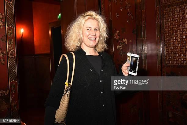 Former Top model Christine Bergstrom attends Sculptor painter Aurele LostDog receives the medal of Chevalier Des arts Et Lettres from designer Agnes...