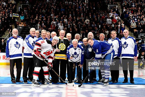 Former Toronto Maple Leaf Darryl Sittler drops the puck with former Boston Bruin Dave Reece during an on ice ceremony to commemorate Darryl Sittlers...
