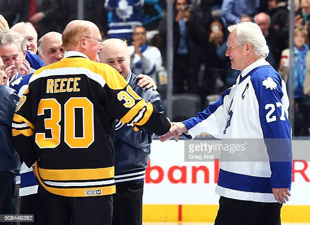 Former Toronto Maple Leaf Darryl Sittler shakes hands with former Boston Bruin Dave Reece during an on ice ceremony to commemorate Darryl Sittlers 10...
