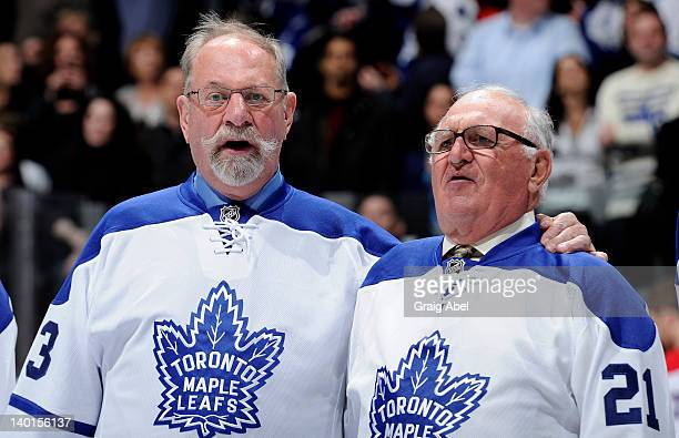 Former Toronto Maple Leafs Eddie Shack and Bob Baun take part in an on ice ceremony prior to NHL game action between the Toronto Maple Leafs and the...