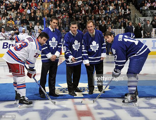 Former Toronto Maple Leafs Mark Osborne Felix Potvin and Bill Berg drop the puck prior to game action against the New York Rangers October 17 2009 at...