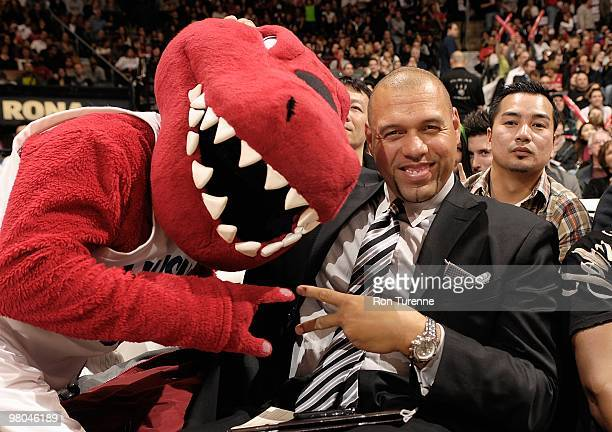 Former Toronto Raptor Tracy Murray poses for a portrait with mascot The Raptor during the game between the New York Knicks and the Toronto Raptors on...
