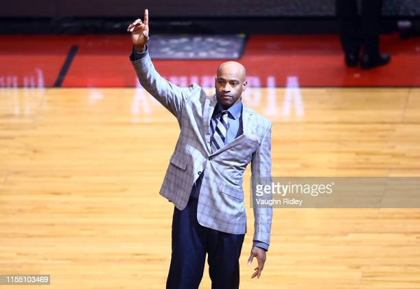 Former Toronto Raptors player Vince Carter waves to the crowd during Game Five of the 2019 NBA Finals between the Golden State Warriors and the...
