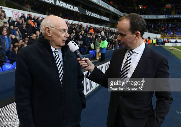 Former Tottenham Hotspur player Alan Gilzean is interviewed at the half time during the Emirates FA Cup Fourth Round match between Tottenham Hotspur...
