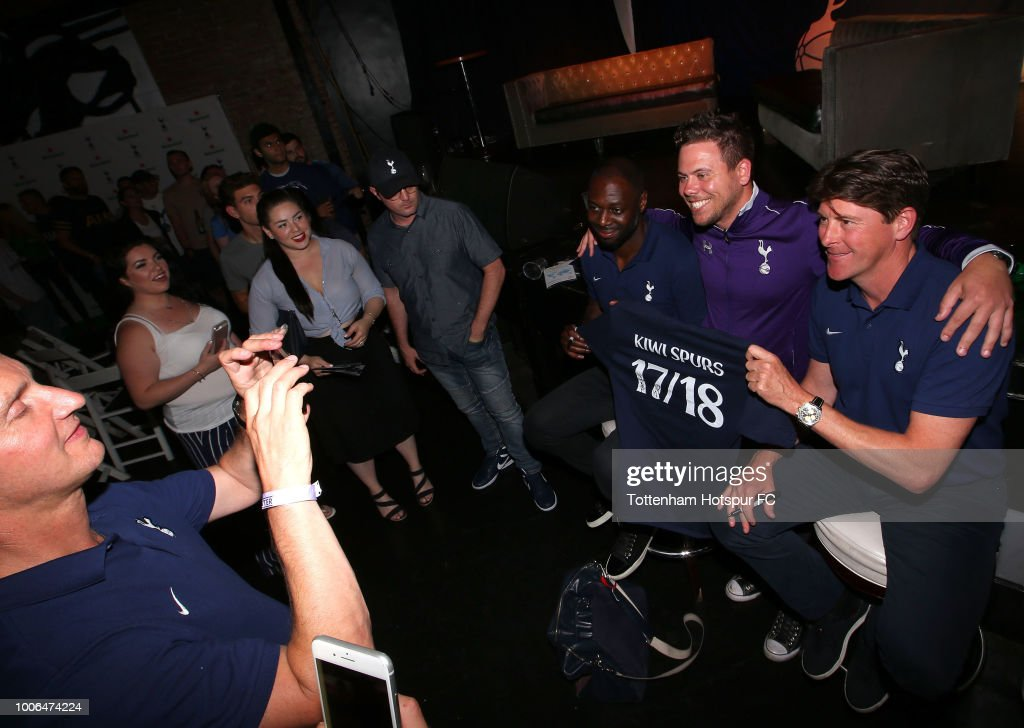 Former Tottenham Hotspur players Darren Anderton and Ledley King pose for a photo with a fan during the Tottenham Hotspur Supporters Club Evening with Ledley King and Darren Anderton at Busby's on July 27, 2018 in Los Angeles, California.