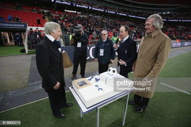 Former Tottenham player Cliff Jones is presented with a comemorative matchday programme by Pat Jennings at half time during the Emirtaes FA Cup...