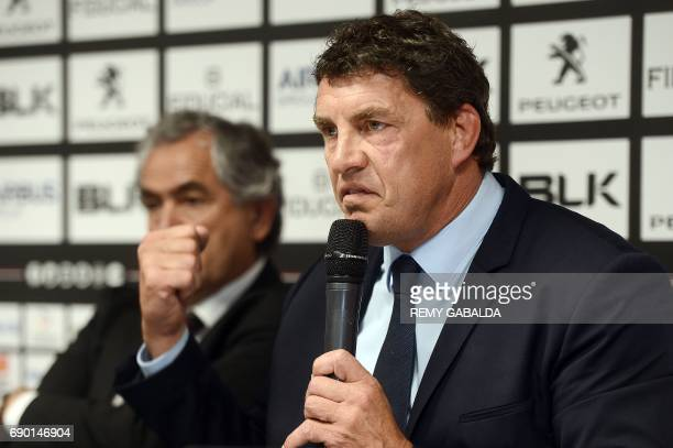 Former Toulouse player Didier Lacroix gestures next to Stade Toulousain Rugby club president Jean Rene Bouscatel during a press conference announcing...