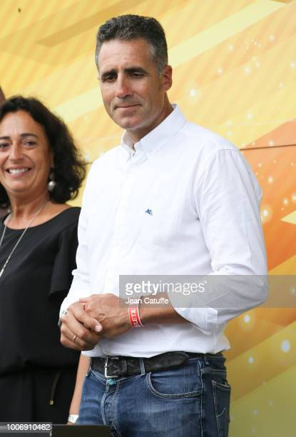 Former Tour de France winner Miguel Indurain of Spain during the podium ceremony following stage 20 of Le Tour de France 2018, an individual time...