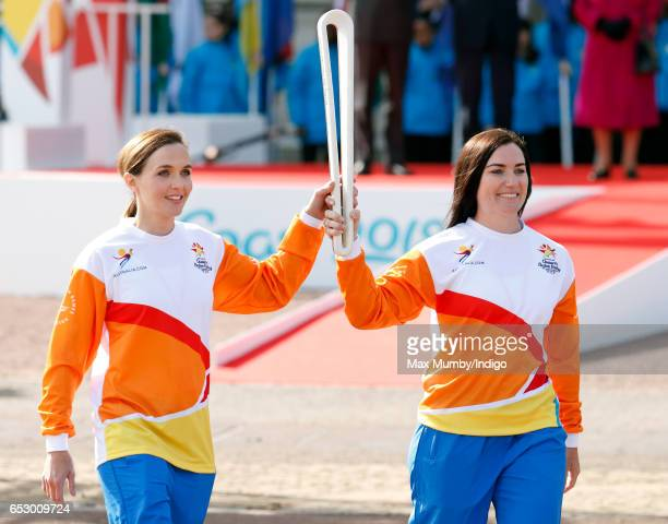 Former track cyclists Victoria Pendleton and Anna Meares hold The Queen's Baton during the launch of The Queen's Baton Relay for the XXI Commonwealth...